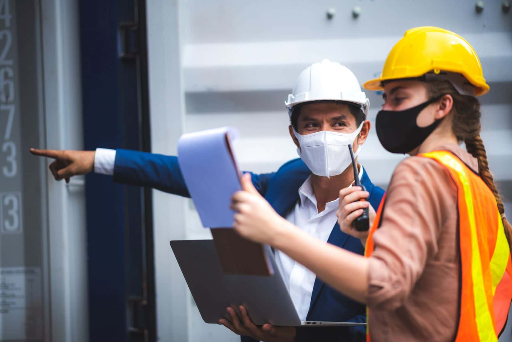 man and woman in hard hats conducting inspection